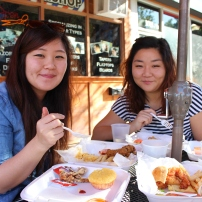 Michelle and Esther Youn eating.