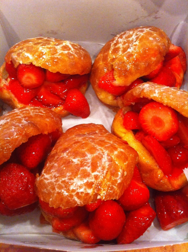 Strawberry filled glazed donuts.
